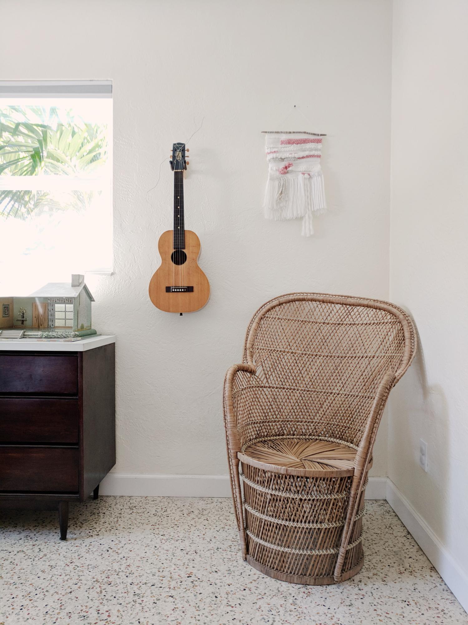 peacock chair, mid century dresser, vintage doll house, vintage guitar, wall art