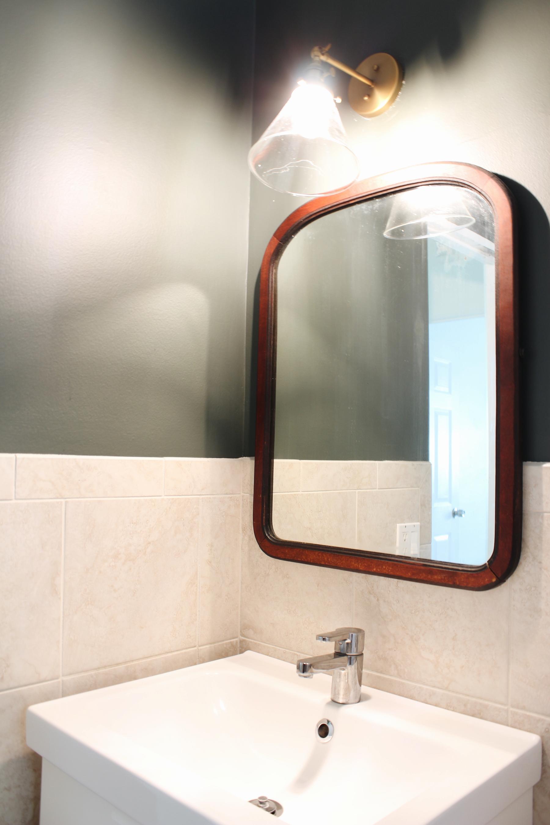 Green bathroom brass light